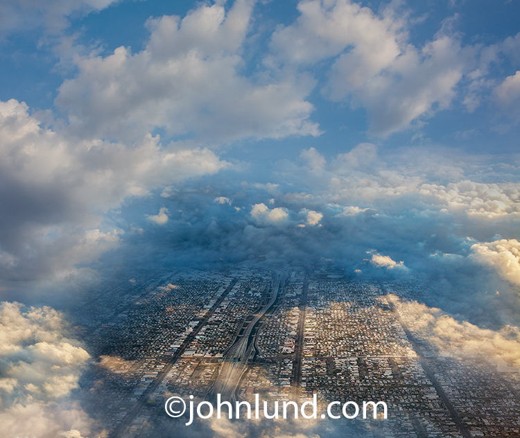Aerial View Of A City Through The Clouds
