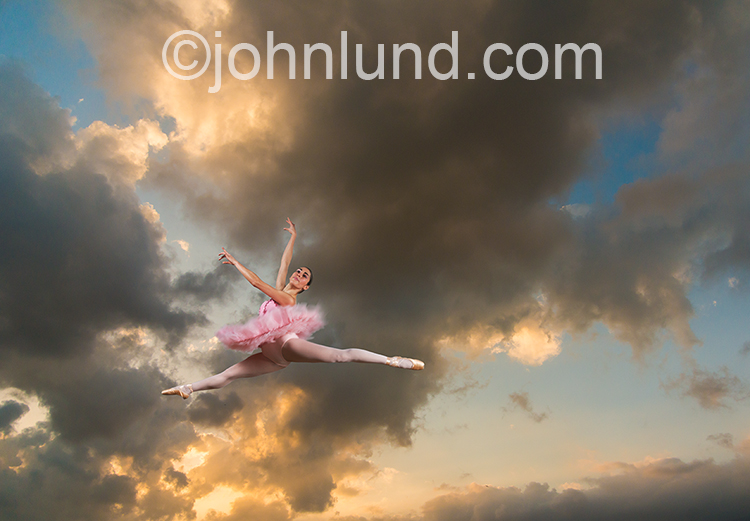 Ballerina Leaping Under Storm Clouds