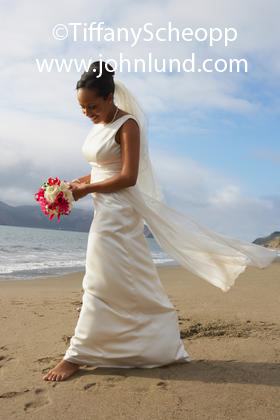 Beautiful Bride Walking Barefoot On the Beach