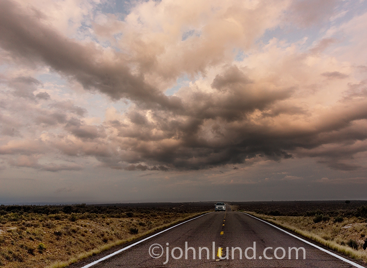 Approaching Car Under Storm Clouds