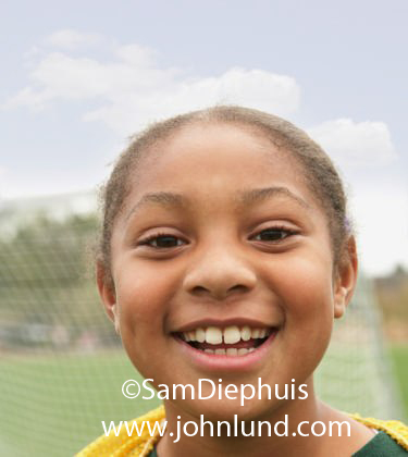 Happy Smiling Close Up of a Young Soccer Playing Black Girl