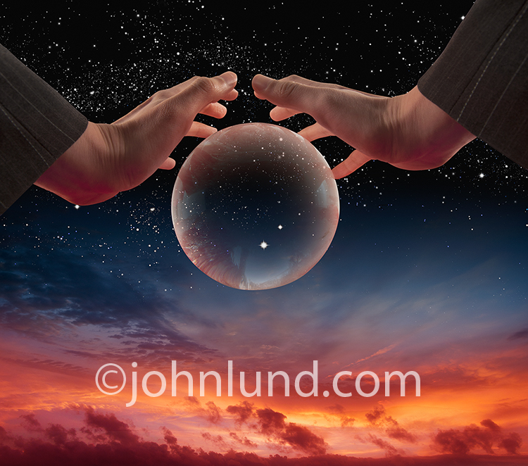 Business Woman's Hands Over Crystal Ball