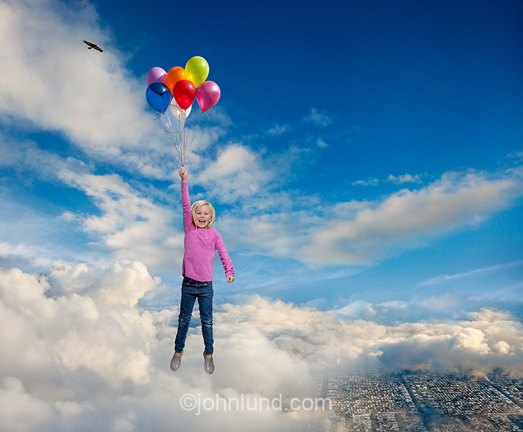 Girl Holding Balloons Floating In Sky