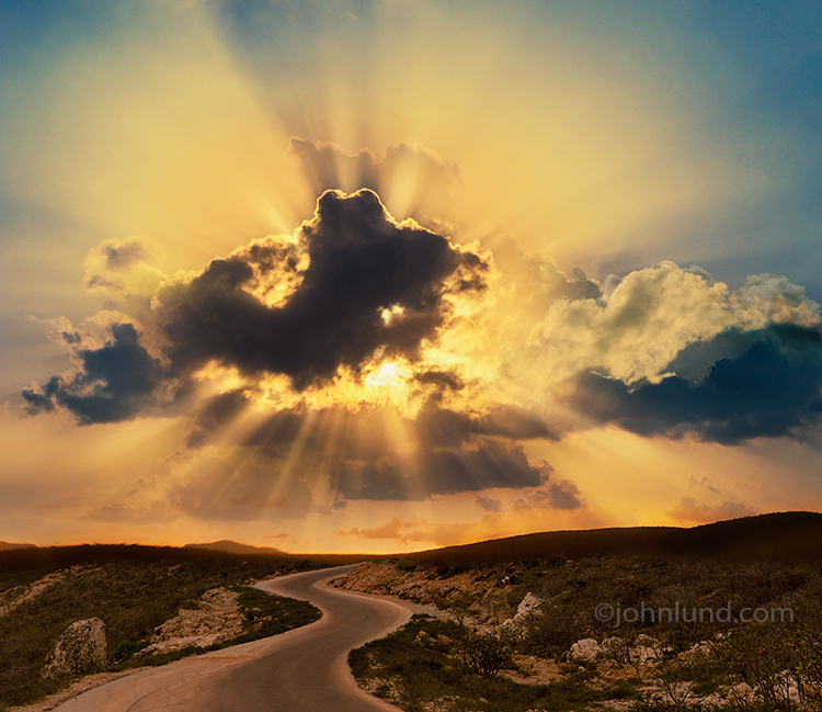 Golden God Rays Over A Winding Road