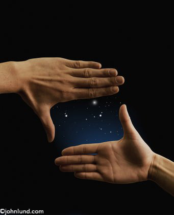 Hands Cropping The Night Sky Showing Imagination and Possibilities