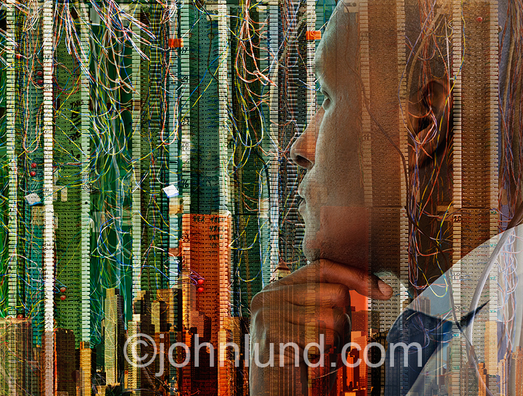 Man Contemplating Technology Cityscape