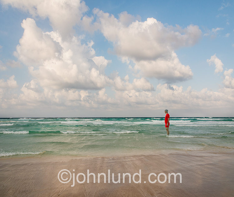 Man Standing In The Water At The Beach
