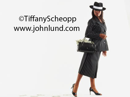 Black Businesswoman With a Purse Overflowing With Money