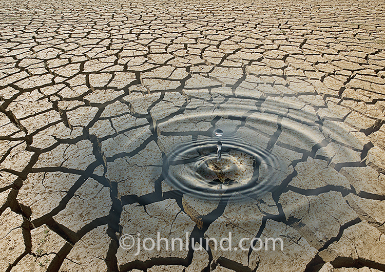Water Dropping On Cracked Dry Earth