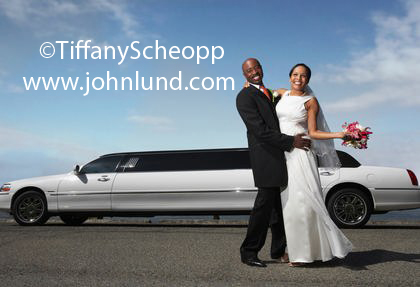 Middle Aged Newlyweds Posing In Front of the Limo