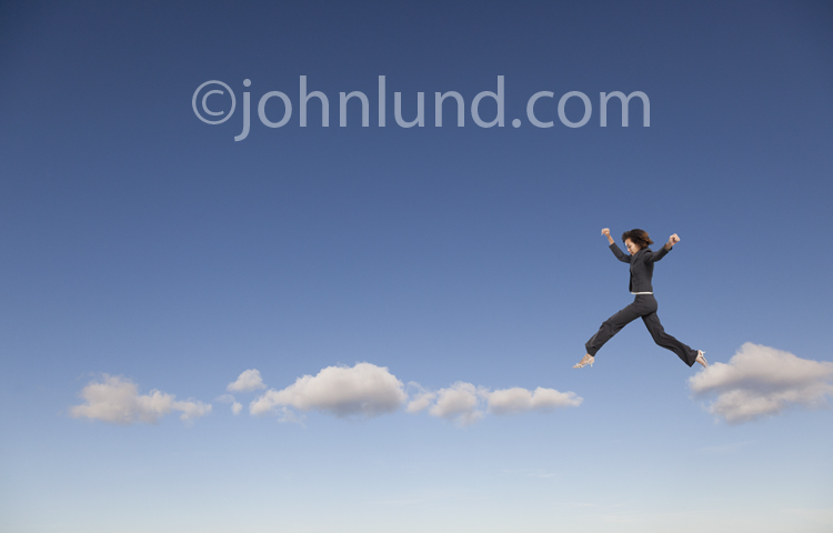Woman Leaping From Cloud To Cloud