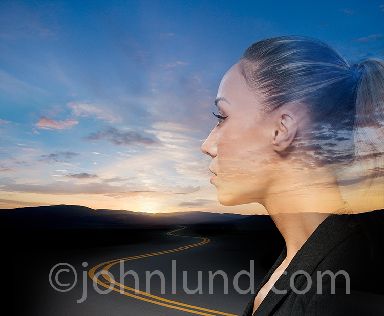 Woman Contemplating The Road To The Future