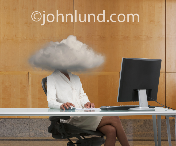 Businesswoman With Her Head In The Cloud