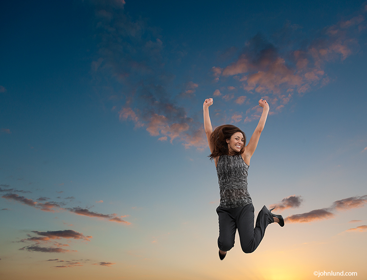 Successful Woman Celebrating With A Sunset Jump