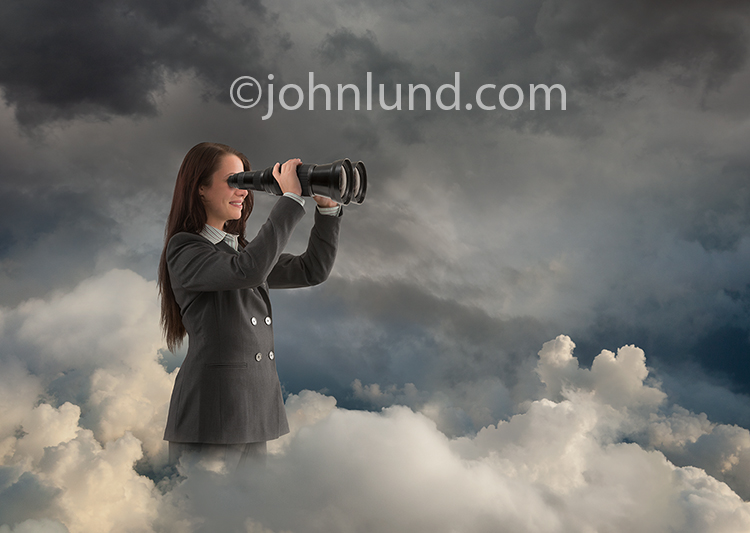 Woman Searching The Cloud With Binoculars