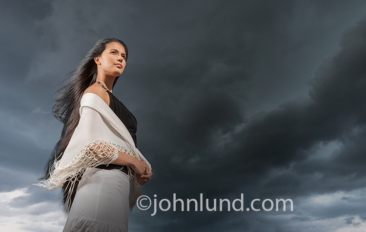 Woman Standing Before An Approaching Storm